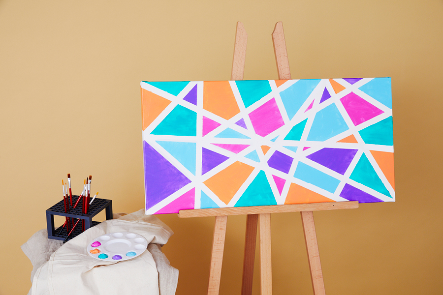 This canvas painting idea is inspired by the art of Piet Mondrian.