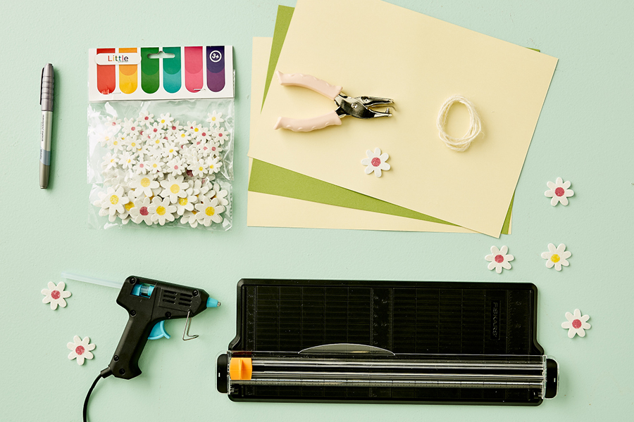 Foam daisy stickers add something special to this DIY invitation.
