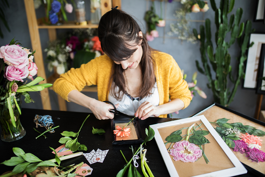 Flower pressing is a beautiful art and craft project for adults that can also be given as a gift.