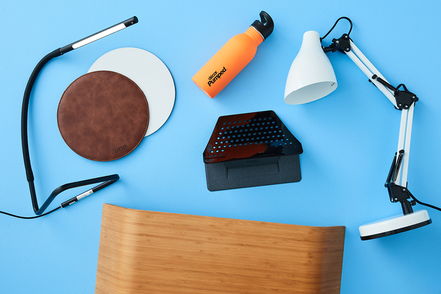 Home office desk essentials include good lighting and a laptop riser.