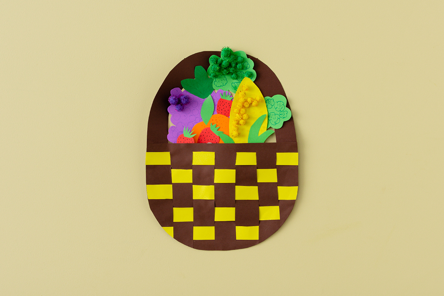 Fun DIY summer crafts for kids include making woven fruit and veggie baskets.