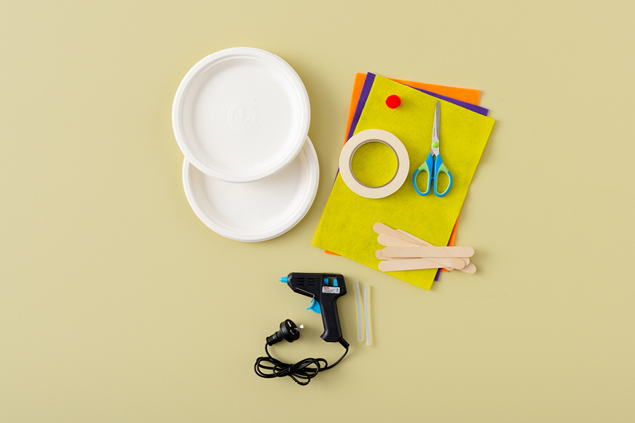 Use a glue gun for cool summer crafts for tweens, like making this paper plate fan.