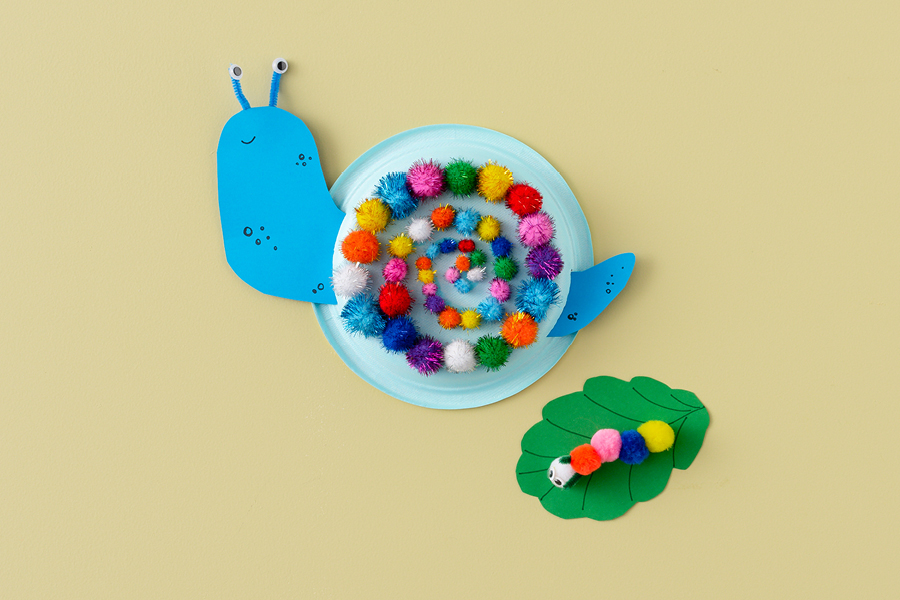 A pom pom beast is a great summer craft idea for kids