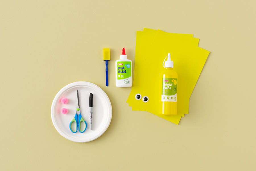 Use googly eyes to make cool summer craft projects for kids like this handprint sun plate.