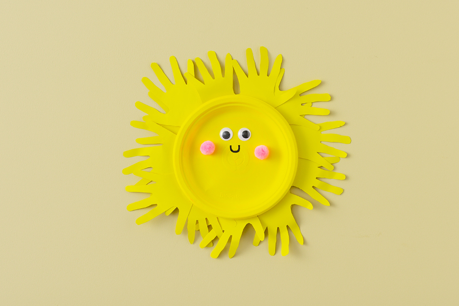 Cool craft projects for kids of all ages include making handprint sun plates.